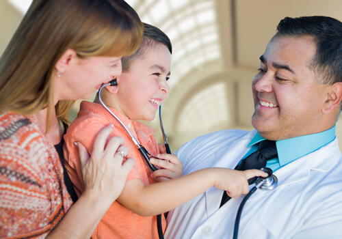 Doctor helping child
